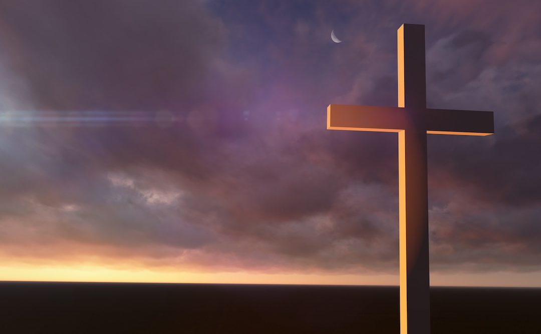 wooden cross against night sky