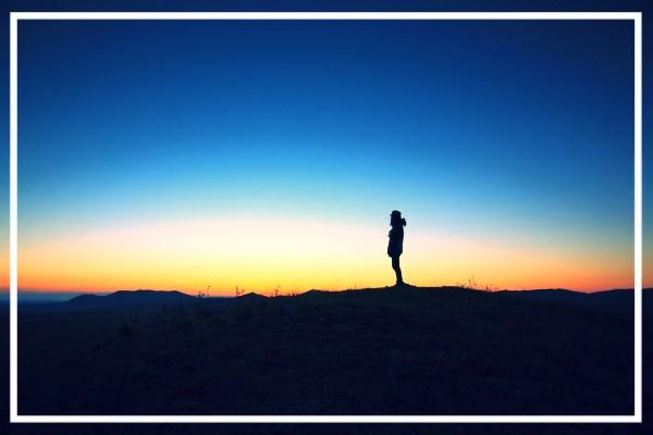 a lone silhouette evening sky barren land