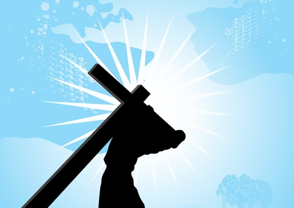 shadow of Jesus carrying cross against blue background